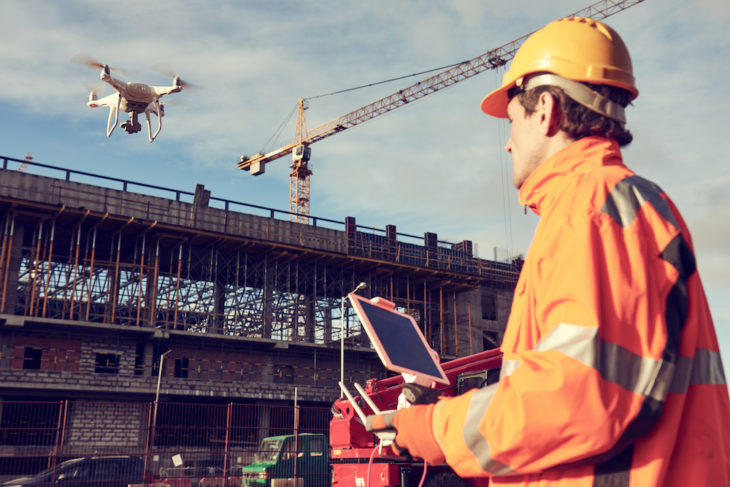 Contractor operating drone | Drones in construction - current and future uses