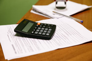 calculator on a desk | Cash Flow Management Strategies for Contractors