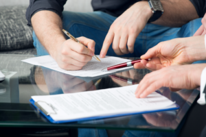 Photo of two people reviewing contracts