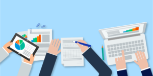 Illustration of revenue recognition tools including laptop, tablet, and paperwork