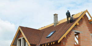 Average time to build a house: Roofers working on home construction
