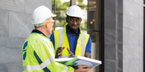 Two contractors reviewing a construction warranty